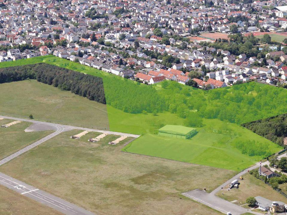 Luftbild von der Konversionsfläche Süd-Ost. Die Fläche für das neue Quartier ist grün markiert.